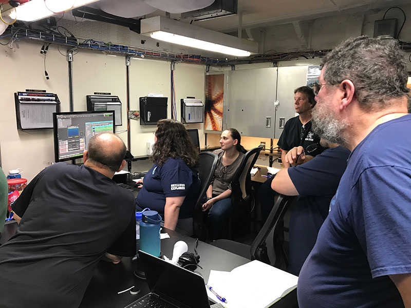 Members of the video and data team learn how to use a new system on board NOAA Ship Okeanos Explorer.
