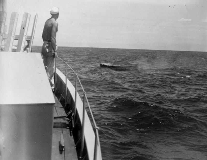 All of the survivors from the attack on the Bloody Marsh were rescued later in the morning by the Submarine Chaser (SC) 1049A. Here a crew member watches one of the lifeboats.