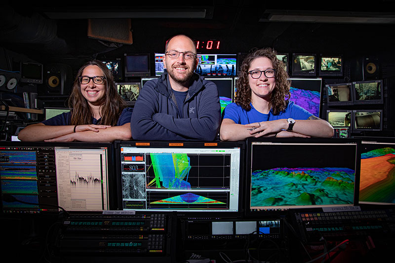 Mapping team of Windows to the Deep 2019 expedition inside the mission control room aboard NOAA Ship Okeanos Explorer.