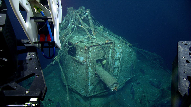 Image from ROV Deep Discoverer of the ship gun fire-control system with base of antenna array and with cylindrical range finder located above the pilot house. The ship gun fire control system is the highest point of the wreck.  Image was taken from the starboard side of the Baldwin, facing port.  Bow is orientated to the right of the image. Note the derelict fishing gear on the wreck.